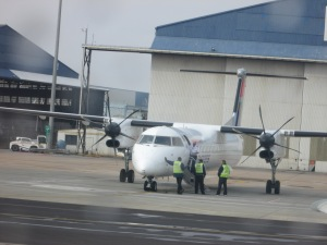 Fortunately NOT our plane. Propellers? This girl would be walking if that were the case!